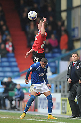 Bristol City's Joe Bryan challenges for the header with Oldham Athletic's Connor Brown - Photo mandatory by-line: Dougie Allward/JMP - Mobile: 07966 386802 - 03/04/2015 - SPORT - Football - Oldham - Boundary Park - Bristol City v Oldham Athletic - Sky Bet League One