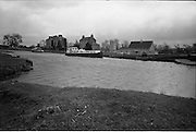 06-10/04/1964.04/06-10/1964.06-10 April 1964.Views on the River Shannon. Like a great tombstone the empty ruin of the old Grand Canal Hotel remind the visitor when this was a great port of activity on the river Shannon at the meeting of the Grand Canal. Co. Offaly.