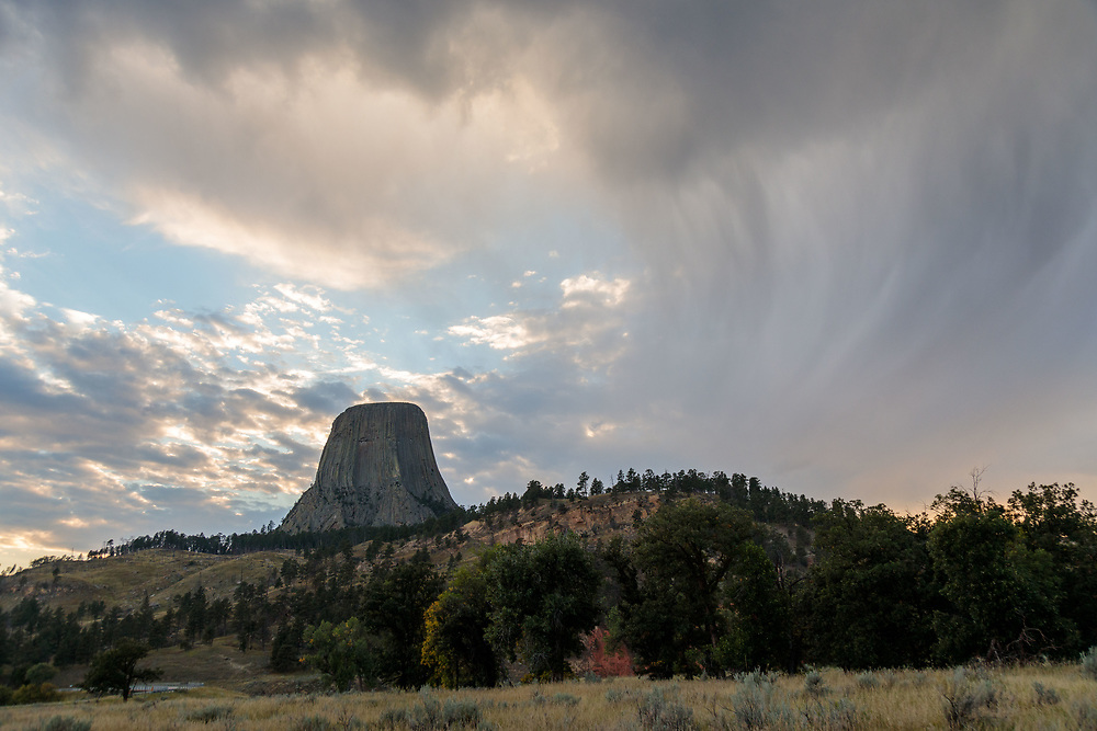 Devil's Tower National Monument with moody clouds