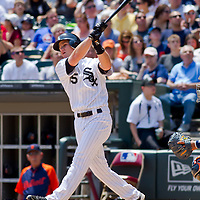 Chicago, IL - June 05, 2011:  Gordon Beckham (15) bats against the visiting Detroit Tigers at U.S. Cellular Field on June 5, 2011 in Chicago, IL.