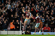 Andy Carroll of West Ham United (l) celebrates after scoring his sides first goal of the game to make it 1-1. Barclays Premier league match, West Ham Utd v Swansea city at the Boleyn ground, Upton Park in London on Sunday 7th December 2014.<br /> pic by John Patrick Fletcher, Andrew Orchard sports photography.