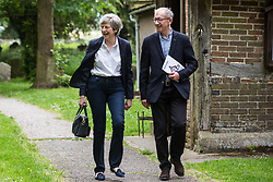 Prime Minister Theresa May leaves church after attending a service close to her Maidenhead constituency two days after announcing the date of her resignation as Conservative party leader.