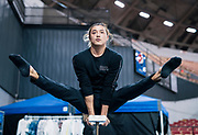 """Hand balancer Lkhagva Ochir warms up  during rehearsal for """"Cirque du Soleil: CRYSTAL"""" at the Alliant Energy Center in Madison, WI on Wednesday, May 1, 2019."""