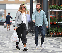 Manchester United's Juan Mata (right) with girlfriend Evelina Kamph spotted in Chesire shopping on July 13, 2018.