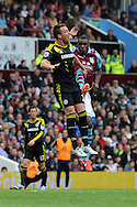 Aston Villa's Christian Benteke is sent off for this foul on Chelsea's John Terry (l), deemed to be a high dangerous tackle..Barclays Premier League, Aston Villa v Chelsea at Villa Park in Birmingham on Saturday 11th May 2013. pic by Andrew Orchard,  Andrew Orchard sports photography,