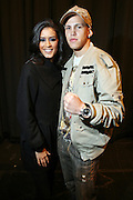 l to r: Jeselene Gonzalez and Jose Guzman at the South Pole Fashion show during ' The Stay in School Concert ' facilated by Entertainers for Education held at The Manhattan Center on October 28, 2008 in New York City