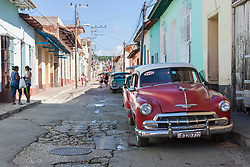Old cars on street of Trinidad old town, Cuba