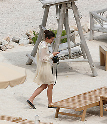 Exclusive - Charlotte Casiraghi takes a smoke break as she leaves a restaurant near Cannes, France, May 22, 2017. NO CREDIT a3