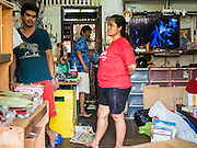 14 SEPTEMBER 2015 - BANGKOK, THAILAND:  People pack up their belongings in a home they said has been in the family for more than 100 years. They're being evicted from the home near Wat Kalanayamit. Fiftyfour homes around Wat Kalayanamit, a historic Buddhist temple on the Chao Phraya River in the Thonburi section of Bangkok are being razed and the residents evicted to make way for new development at the temple. The abbot of the temple said he was evicting the residents, who have lived on the temple grounds for generations, because their homes are unsafe and because he wants to improve the temple grounds. The evictions are a part of a Bangkok trend, especially along the Chao Phraya River and BTS light rail lines. Low income people are being evicted from their long time homes to make way for urban renewal.           PHOTO BY JACK KURTZ