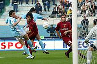 Roma 21/4/2004 Campionato Italiano Serie A <br />Lazio - Roma 1-1 <br />Colpo di testa di Gaetano D'Agostino (Roma)<br />An head shot of Gaetano D'Agostino (Roma)<br />Lazio and Roma are playing again after it was suspended on March 21, 2004, for security reasons.  <br />Foto Andrea Staccioli Graffiti