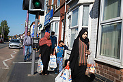 Muslim family walk back with their shopping in the inner city area of Birchfield under Coronavirus lockdown on 6th May 2020 in Birmingham, England, United Kingdom. Coronavirus or Covid-19 is a new respiratory illness that has not previously been seen in humans. While much or Europe has been placed into lockdown, the UK government has put in place more stringent rules as part of their long term strategy, and in particular social distancing.