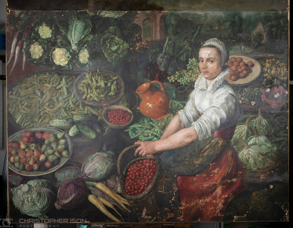 IMAGE FOR REFERENCE<br /> The Vegetable Seller, currently attributed to Joachim Beuckelaer, pictured the the conservator's studio at Ranger's House, Blackheath, London.<br /> Picture date: Monday March 25, 2019.<br /> Photograph by Christopher Ison for English Heritage ©<br /> 07544044177<br /> chris@christopherison.com<br /> www.christopherison.com