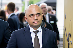 © Licensed to London News Pictures. 03/06/2018. London, UK. Home Secretary Sajid Javid leaves after laying flowers to mark one year since the London Bridge and Borough Market terror attacks. A series of events have taken place throughout the day, including a service of commemoration at Southwark Cathedral, the planting of an olive tree in the Cathedral grounds, a minute's silence at 4:30pm and the laying of flowers.  Photo credit : Tom Nicholson/LNP