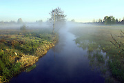 Mist hangs over the river Ise and the Ise valley near Kettering, Northamptonshire