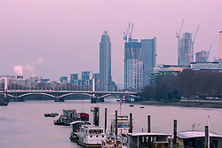 © Licensed to London News Pictures. 11/02/2021. London, UK. Sunrise over the River Thames from Chelsea South West London as the Met Office issue weather warnings for extreme cold with temperatures dropping to as low as -10c last night in the South East as Storm Darcy continues to bring freezing weather and travel chaos to the UK.  Photo credit: Alex Lentati/LNP