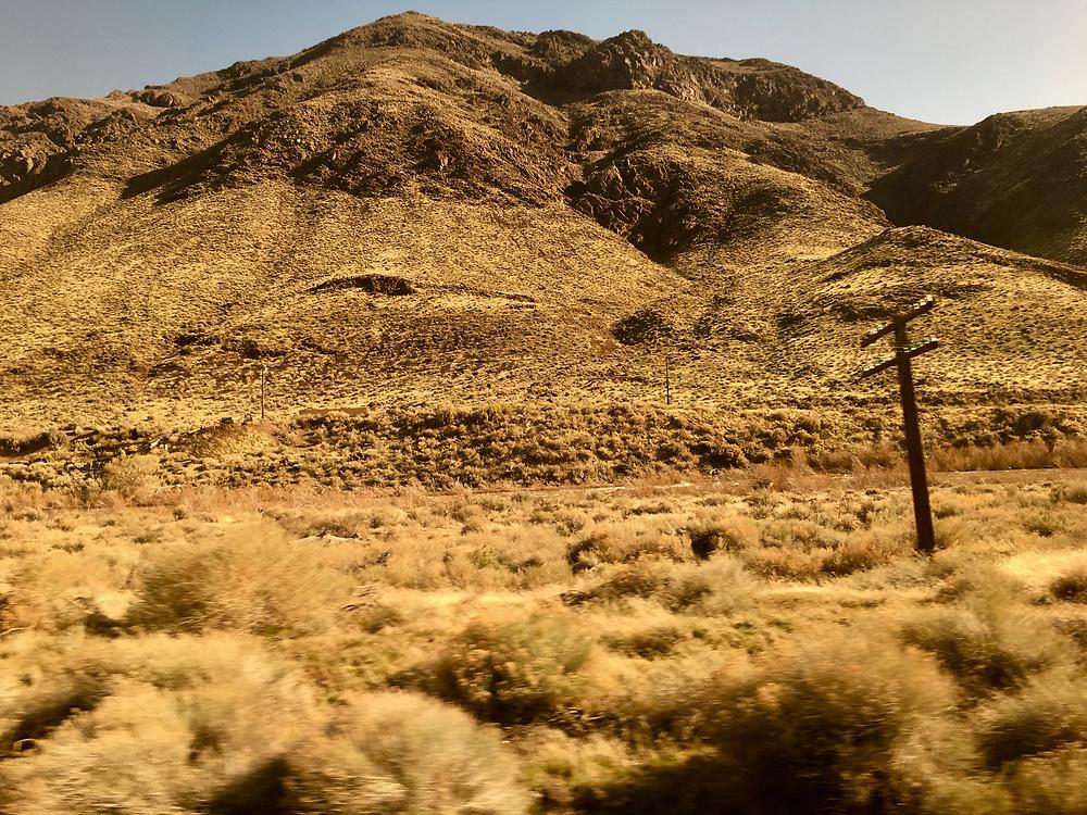 Amtrak Zephyr landscape view, Clifton Colorado, winter grassland and mountain