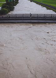 29.07.2019, Hollersbach, AUT, Hochwasser in Oesterreich, Salzburg, im Bild ein fussgaenger auf einer Bruecke ueber die Hochwasser fuehrende Salzach. Nach Starkregen sind die Pegelstaende der Fluesse in Salzburg und in weiten teilen Oesterreichs stark angestiegen // a pedestrian walks over a bridge at the river Salzach. After heavy rainfall, the water levels of the rivers in Salzburg and in large parts of Austria have risen dramatically. Hollersbach, Austria on 2019/07/29. EXPA Pictures © 2019, PhotoCredit: EXPA/ JFK