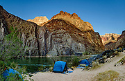 """Schist Camp at Colorado River Mile 96.5 (measured downstream from Lees Ferry). Day 6 of 16 days rafting 226 miles down the Colorado River in Grand Canyon National Park, Arizona, USA. Multiple overlapping photos were stitched to make this panorama. """"The rocks of the Vishnu Formation, predominantly mica schists, are the oldest in the Grand Canyon. Approximately 2 billion years ago, 25,000 feet of sediments were deposited and volcanics extruded onto the ancient sea floor. During an orogeny, a mountain-building episode, 1.7 billion years ago, those rocks were folded, faulted, and uplifted (metamorphosed), and intruded by the Zoroaster Formation, predominantly granite (also subsequently metamorphosed to form granite gneiss). The resulting mountain range is believed to have been 5-6 miles high. Over the next 500 million years, the mountains were eroded until only their roots remained, and today, the roots of those mountains form the steep walls of the inner gorge."""" - geologistwriter.com"""