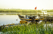 June 2-18, Cam Kim Island: Morning time at a misty place with fishing boats and a beautiful river that runs through the grass.