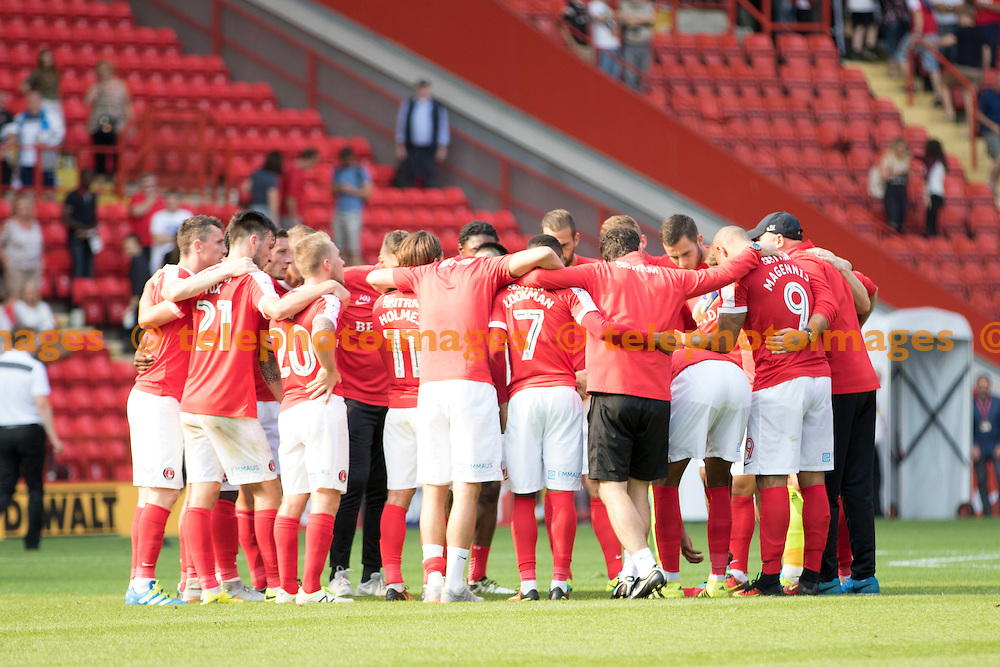 Charlton Athletic FC Manager Russell Slade gathers his team after saving a point against Bolton Wanderers FC during the Sky Bet League 1 match between Charlton Athletic and Bolton Wanderers at The Valley in London. August 27, 2016.<br /> Sam Falaise / Telephoto Images<br /> +44 7967 642437