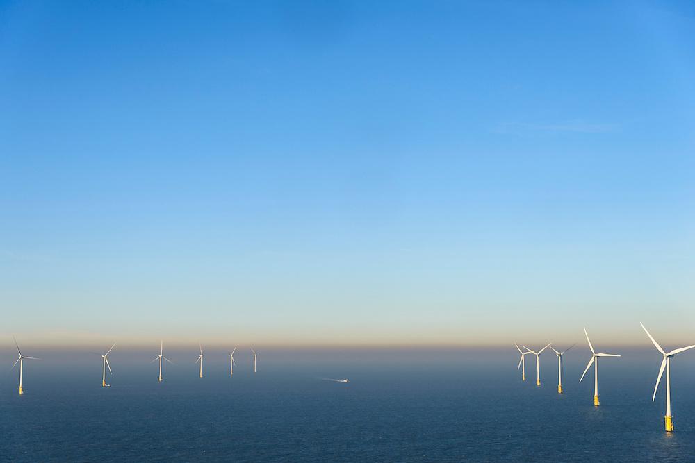 Nederland, Noord-Holland, IJmuiden, 11-12-2013; offshore Prinses Amaliawindpark telt 60 windturbines en is gebouwd door Eneco en Econcern. Het windmolenpark ligt 23 km uit de kust bij IJmuiden (blok Q7 van het Nederlands continentaal plat).<br /> The Princess Amalia offshore Wind Farm consists of 60 wind turbines and is located in block Q7 of the Dutch Continental Shelf, 23 km from the shore.<br /> luchtfoto (toeslag op standaard tarieven);<br /> aerial photo (additional fee required);<br /> copyright foto/photo Siebe Swart.