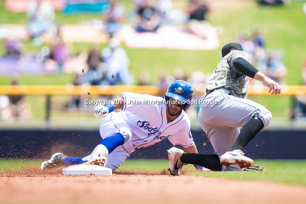 Amarillo Sod Poodles infielder Ivan Castillo (2) slides in to second base against the Arkansas Travelers on Sunday, May 5, 2019, at HODGETOWN in Amarillo, Texas. [Photo by John Moore/Amarillo Sod Poodles]