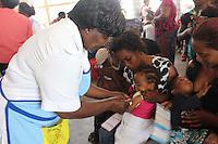 Sister Elizabeth Nyirenda prepares to immunize children at Metero Reference Clinic in Lusaka, Zambia on Wednesday 12th November 2014.