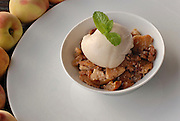 Peach Crumble and ice cream garnished with a mint leaf