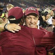 Florida State Seminoles head coach Jimbo FIsher hugs former player Jameis Winston after winning a NCAA football game between the Ole Miss Rebels and the Florida State Seminoles at Camping World Stadium on September 5, 2016 in Orlando, Florida. (Alex Menendez via AP)