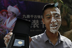 June 28, 2017 - China - Sichuan, CHINA-June 28 2017: (EDITORIAL USE ONLY. CHINA OUT) Visitors attend a yogurt drinking contest in Jiuzhaigou Scenic Area in southwest China's Sichuan Province, June 28th, 2017. Participants can't drink the yogurt with spoon during the contest. A man won the contest by drinking two bowls of yogurt in five minutes. (Credit Image: © SIPA Asia via ZUMA Wire)
