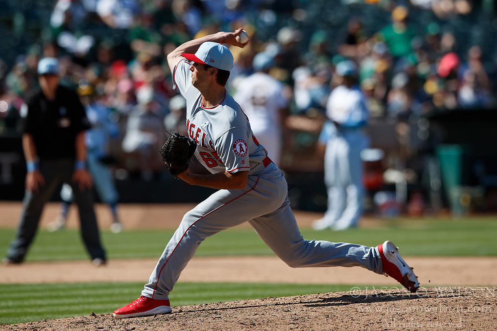OAKLAND, CA - JUNE 17: Jake Jewell #65 of the Los Angeles Angels of Anaheim pitches against the Oakland Athletics during the eleventh inning at the Oakland Coliseum on June 17, 2018 in Oakland, California. The Oakland Athletics defeated the Los Angeles Angels of Anaheim 6-5 in 11 innings. (Photo by Jason O. Watson/Getty Images) *** Local Caption *** Jake Jewell