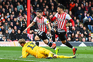 Brentford Forward Said Benrahma (21) takes a shot on goal but misses the target during the EFL Sky Bet Championship match between Brentford and Queens Park Rangers at Griffin Park, London, England on 2 March 2019.