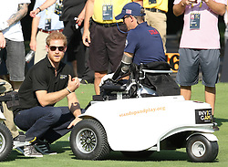 Prince Harry Attended the Invictus inaugural golf tournament at St Georges Golf course Toronto and congratulated triple amputee Micheal Nicholson on a superb tee off from the 16th tee<br /><br />26 September 2017.<br /><br />Please byline: Vantagenews.com