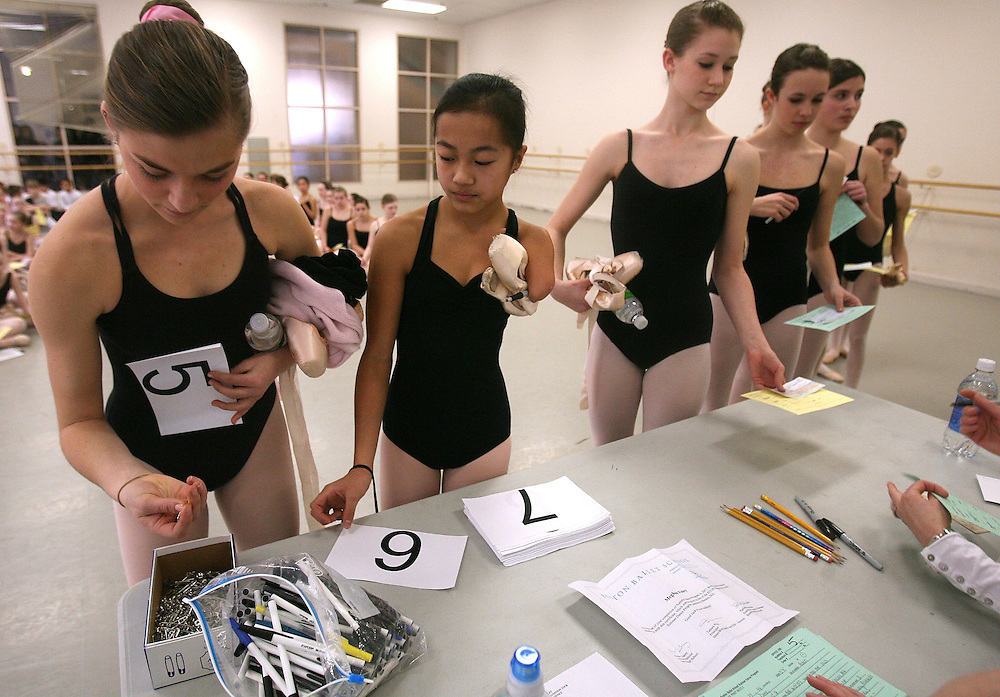 Lani Dickinson, 14, was born in China and adopted as an infant by her mother Julie Bell.  Lani, born with the congenital defect that cost her her left arm, first took up dance as a sort of physical therapy to work on her posture and alignment.  She soon fell in love with ballet and now, despite painful surgeries and occasional discouragement, Lani vehemently pursues a path towards being a professional dancer in the ultra competitive dance world.  This story follows Lani through a year in her life.  ..(020809 Boston, MA)  Lani Dickenson, 14, auditions for the Boston Ballet Company's Summer Dance Program.  Photo by Lisa Hornak