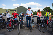 A group of men and women prepare to cycle electric bikes after a wine tasting session at Hush Heath Winery, Staplehurst, Kent, England, UK. (photo by Andrew Aitchison / In pictures via Getty Images)