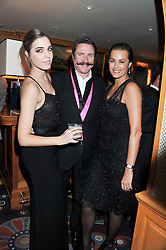 Left to right, AMBER LE BON and SIMON & YASMIN LE BON at the Johnnie Walker Blue Label and David Gandy partnership launch party held at Annabel's, 44 Berkeley Square, London on 5th February 2013.