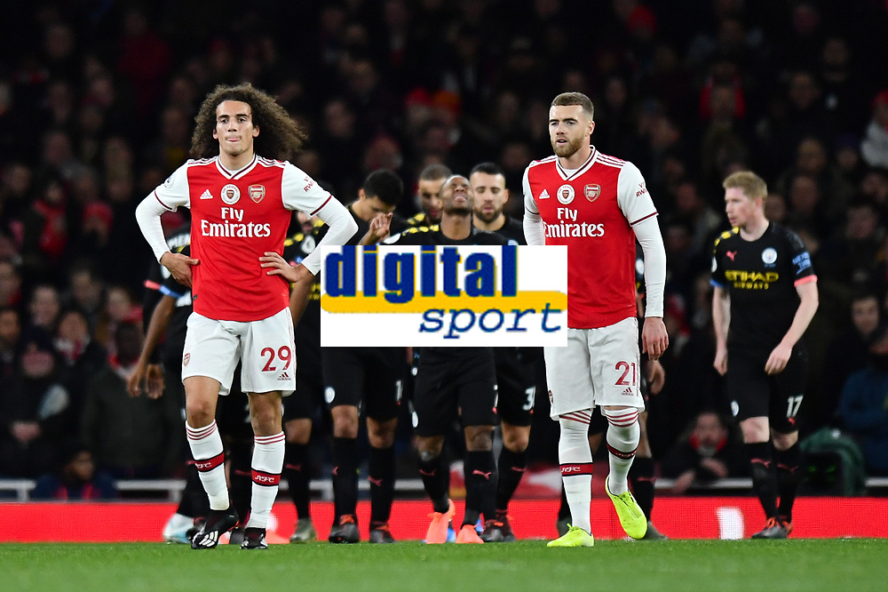 Football - 2019 / 2020 Premier League - Arsenal vs. Manchester City<br /> <br /> Arsenal's Matteo Guendouzi and Calum Chambers dejected as Manchester City's Raheem Sterling scores his side's second goal, at The Emirates.<br /> <br /> COLORSPORT/ASHLEY WESTERN