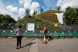 © Licensed to London News Pictures. 04/08/2021. London, UK. People walk past THE MARBLE ARCH MOUND as repairs continue after closing two days of opening. London's latest £2 million attraction was to generate tourism and trade to Oxford Street. Instead, visitors have criticised the project as a major flop. Photo credit: Ray Tang/LNP