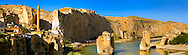 Remains of medieval Artukid Old Tigris Bridge – Built in 1116 by Artukid Fahrettin Karaaslan, the biggest in Anatolia at the time, with the old town Hasankeyf and its ruins on the cliffs abover the river Tigris. The minaret is of the El Rizk Mosque built 1409.  Turkey. 3 .<br /> <br /> If you prefer to buy from our ALAMY PHOTO LIBRARY  Collection visit : https://www.alamy.com/portfolio/paul-williams-funkystock/hasankeyf-turkey.html<br /> <br /> Visit our PHOTO COLLECTIONS OF TURKEY HISTOIC PLACES for more photos to download or buy as wall art prints https://funkystock.photoshelter.com/gallery-collection/Pictures-of-Turkey-Turkey-Photos-Images-Fotos/C0000U.hJWkZxAbg