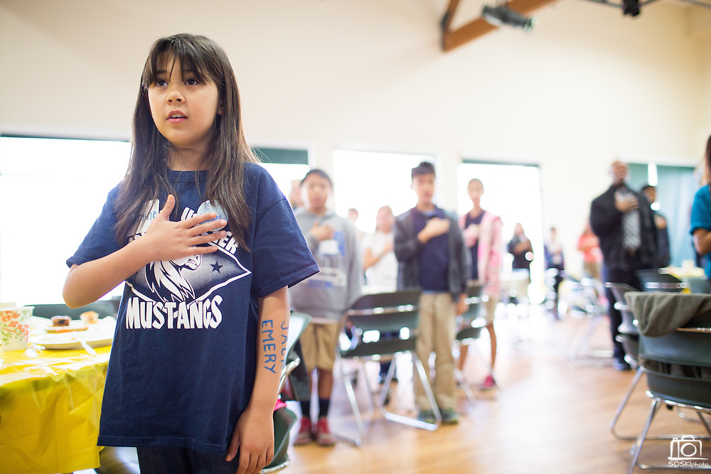 Jasmine Kelly-Tanti, 9, of Weller stands during the Pledge of Allegiance during the Jack Emery Food Drive luncheon at Milpitas Community Center in Milpitas, California, on November 4, 2014. (Stan Olszewski/SOSKIphoto)