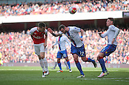 Laurent Koscielny of Arsenal heads the ball over Damien Delaney of Crystal Palace. Barclays Premier league match, Arsenal v Crystal Palace at the Emirates Stadium in London on Sunday 17th April 2016.<br /> pic by John Patrick Fletcher, Andrew Orchard sports photography.