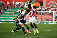 Mame Biram Diouf of Stoke City looks to go between James Morrison and Craig Dawson of West Bromwich Albion.  Barclays Premier League match, Stoke city v West Bromwich Albion at the Britannia stadium in Stoke on Trent, Staffs on Saturday 29th August 2015.<br /> pic by Chris Stading, Andrew Orchard sports photography.
