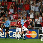 Denmark's Jon Dahl Tommasson celebrates scoring the winning goal against Uruguay
