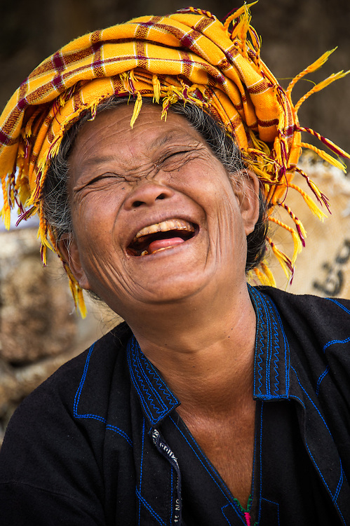 INLE LAKE, MYANMAR - CIRCA DECEMBER 2013: Happy burmese woman in the Taung Tho Market in Inle Lake, Myanmar