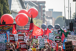 © Licensed to London News Pictures. 04/10/2015. Manchester, UK. Picture shows crowds gathering at the Anti Austerity protest in Manchester expected to attract thousands of people to protest against Austerity cuts at the start of the Conservative Party Conference in the city. Photo credit: Andrew McCaren/LNP