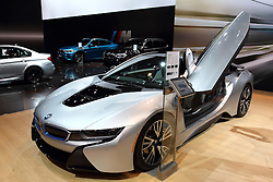 "12 February 2015: 2015 BMW i8 Hybrid: One of the few places you will see the exotic BMW i8 Hybrid sports car is at the 107th annual Chicago Auto Show, Feb.14-22, 2015. BMW touts the i8 as ""Progress in Motion,"" due to the highly emotional design, dynamic performance, and fuel efficiency and emissions figures worthy of a compact car. Groundbreaking eDrive plug-in hybrid technology combines the modified electric drive system from the BMW i3 producing 131horsepower at the front wheels, and a three-cylinder TwinPower turbo motor producing 231hp at the rear wheels. Working in tandem, they allow the two drive systems to display their respective talents, delivering drive performance of a true sports car, with an acceleration of 0-to-60 mph in 4.4 seconds, in a vehicle that is also capable of achieving up to an estimated 94 mpg. It can operate solely on electric power up to 22 miles, which means no driving tailpipe emissions to a maximum eDrive speed of 75 mph. Visually, the exterior includes sweeping lines, short front/rear overhangs, and flat silhouette lend the vehicle a striking appearance. Note the large, transparent greenhouse over the 2+2 cabin, and how the doors swing upwards like wings. Thanks to the dual drive systems, all four wheels of the BMW i8 Concept can be driven at the same time, similar to an all-wheel-drive vehicle. This solution combines the advantages of front-wheel drive, rear-wheel drive and all-wheel drive to ensure the optimal dynamic drive configuration as required.<br /> <br /> First staged in 1901, the Chicago Auto Show is the largest auto show in North America and has been held more times than any other auto exposition on the continent. The 2015 show marks the 107th edition of the Chicago Auto Show. It has been  presented by the Chicago Automobile Trade Association (CATA) since 1935.  It is held at McCormick Place, Chicago Illinois"