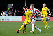 Shaun Harrad and Carl McHugh battle for the ball during the Sky Bet League 2 match between Cheltenham Town and Plymouth Argyle at Whaddon Road, Cheltenham, England on 28 March 2015. Photo by Alan Franklin.