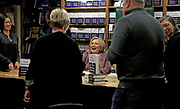 """Hillary Clinton talks with fans and signs her new book, """"What Happened,"""" at Elliott Bay Book Company in Seattle on Tuesday. (Erika Schultz/The Seattle Times)"""