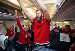 ZENICA, BOSNIA & HERZEGOVINA - Sunday, October 11, 2015: Wales' Sam Vokes, Gareth Bale and Joe Ledley on the team's return flight to Cardiff after qualifying for the UEFA Euro 2016 finals despite a 2-0 defeat to Bosnia and Herzegovina during the UEFA Euro 2016 qualifying match. (Pic by David Rawcliffe/Propaganda)