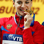 Russia's gold medallist Yelena Isinbayeva bites her gold medal on the podium during the medal ceremony for the women's pole vault at the during the IAAF World Indoor Championships at the Atakoy Athletics Arena, Istanbul, Turkey. Photo by TURKPIX